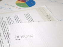 Resume sitting with several documents Royalty Free Stock Photography