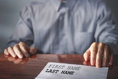 Job interview. Resume of applicant on table.Employer conducting job interview. stock images