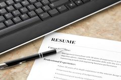 Resume on the Table. Closeup of Resume with Pen and Keyboard on the Table stock image