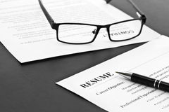 Resume on the Table. Closeup of resume with pen and glasses on the table royalty free stock photo