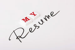 Resume word. The Resume word is written by a marker on a white surface and nearby the word My, made of ceramic letters is placed stock photos