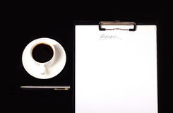 Resume writing. Written on a paper resume with a pen and tablet royalty free stock photos