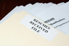 Resumes. File with stack of resumes received Royalty Free Stock Images