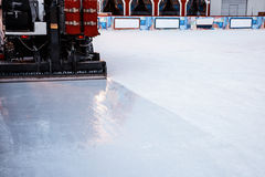 Resurfacer ice machine smooths the ice rink. Bottom part - rubber knife stock photography