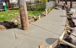Resurfacing urban sidewalk Royalty Free Stock Images