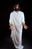 The Resurrected Jesus Christ reaching out Royalty Free Stock Photos
