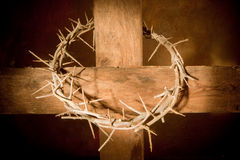 Resurrection. Crown of thorns hanging on a wooden cross at Easter stock photo