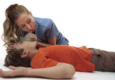 Resuscitating unconscious boy. Female nurse using a resuscitation mask on a young unconscious boy.  Focus to boy Royalty Free Stock Photography