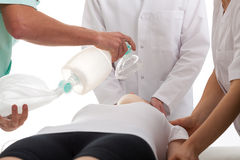 Resuscitation. Doctors making resuscitation on young girl who was fainted royalty free stock photos