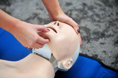 Resuscitation procedure on a mannequin Royalty Free Stock Photo