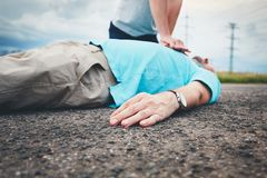 Resuscitation on the road. Dramatic resuscitation on the rural road. Themes rescue, help and hope Royalty Free Stock Photo