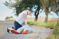 Resuscitation on the road. Dramatic resuscitation on the rural road. Themes rescue, help and hope Stock Photography