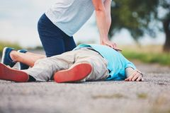 Resuscitation on the road. Dramatic resuscitation on the rural road. Themes rescue, help and hope Stock Photos