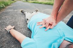 Resuscitation on the road. Dramatic resuscitation on the rural road. Themes rescue, help and hope Royalty Free Stock Image