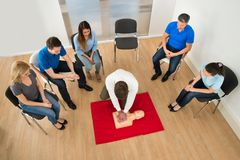 Resuscitation training. First Aid Instructor Showing Resuscitation Technique On Dummy Royalty Free Stock Images