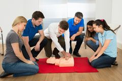 Resuscitation training. First Aid Instructor Showing Resuscitation Technique On Dummy Stock Image