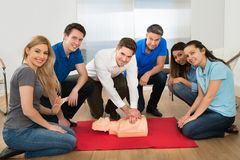 Resuscitation training using first-aid dummy Stock Photography