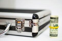 Resväska med dollar Arkivbilder