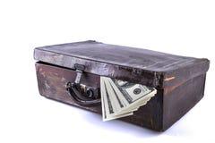 Resväska och pengar Royaltyfri Bild