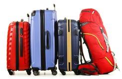 Resväskor och ryggsäck på vit royaltyfria bilder