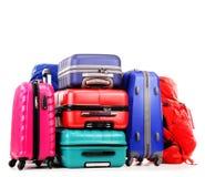 Resväskor och ryggsäckar på vit Arkivbilder