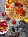Resveratrol rich food on wooden surface, antioxidants, decorated with wine corks. Antioxidants, resveratrol food as grape, blueberry, strawberry, tomatoes royalty free stock photography