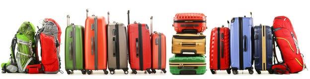 Resväskor och ryggsäckar på vit bakgrund Royaltyfria Foton