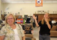 Retail Associate Helping Customer. Photo of a Retail Associate Helping Customer stock photo