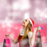 Retail christmas holiday woman with store bags Royalty Free Stock Photos