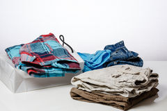 Retail - Clothing is on sales counter.  Royalty Free Stock Photography