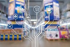 Retail concept marketing channels E-commerce Shopping automation on blurred supermarket background. Retail concept marketing channels E-commerce Shopping royalty free stock image