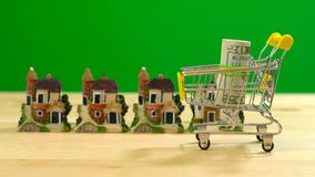 Retail estate shopping for houses concept with miniature shopping cart stock image