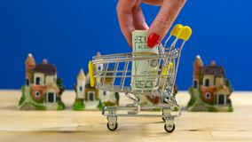 Retail estate shopping for houses concept with miniature shopping cart royalty free stock image