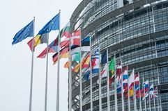 Retail of facade with flags of european union parliament. Strasbourg - France - 24 December 2017 - retail of facade with flags of european union parliament Royalty Free Stock Photo