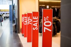 Retail Image Of A Sale Sign In A Clothing Store Window.Retail Image Of A Final Sale Sign In A Clothing Store.shopping. Retail Image Of A Sale Sign In A Clothing royalty free stock photography