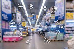 Retail marketing channels E-commerce Shopping automation concept on blurred supermarket background. Retail marketing channels E-commerce Shopping automation royalty free stock images