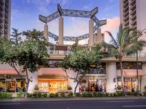 Retail outlets on Kalakaua Avenue. WAIKIKI, HI - APRIL 27: Retail outlets on Kalakaua Avenue on April 27, 2014 in Waikiki, Hawaii. Kalakaua Avenue is the royalty free stock image