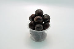 Retail pack of cherries. Against a light blue background Stock Image