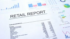 Retail report lying on table, graphs charts and diagrams, official document. Stock photo royalty free stock photo