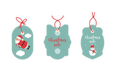 Retail Sale Tags and Clearance Tags. Festive christmas design. Santa Claus, snowflakes and snowman.  Royalty Free Stock Image