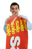 Retail shopkeeper with sale sign, royalty free stock photos