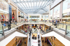 Retail shopping mall. Modern retail shopping mall / centre with many busy shoppers shopping Royalty Free Stock Photo