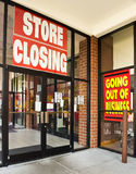Retail Store Going Out of Business. A store showing going out of business signs Stock Image