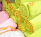 Retail store selling cloth. Pink and green cloth for sale in retail store Stock Photography