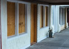 Retail storefront closed and boarded royalty free stock image