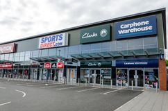 Retail stores at Prestatyn. Prestatyn, UK: June 3, 2018: The Carphone Warehouse standalone store on the Parc Prestatyn Retail Park. Clarkes, Sports Direct and TK royalty free stock images