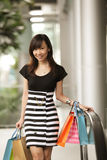 Retail Therapy. Concept with Asian Female and Bags Royalty Free Stock Photo