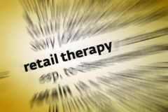 Retail Therapy. Is shopping with the primary purpose of improving the buyer's mood. Often seen in people during periods of depression or transition, it is royalty free stock images