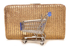 Retail therapy shopping trolley and handbag. Cutout Stock Photos