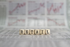 RETAIL. Word built with letter cubes on newspaper background royalty free stock photography